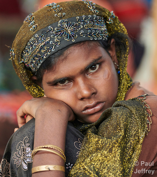 A Rohingya woman, having just crossed the border from Myanmar, waits to complete registration in the Kutupalong Refugee Camp near Cox's Bazar, Bangladesh. More than 600,000 Rohingya have fled government-sanctioned violence in Myanmar for safety in Bangladesh.