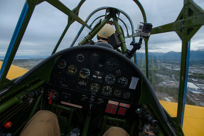 Anchorage Press photographer James R. Evans enjoys a warbird ride over Anchorage in a 1944 Vultee BT-13 flown by Gordon Bartell, a pilot with the Alaska Wing of the Commemorative Air Force at Merrill Field.