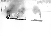 Rotary snowplow OM being pushed by 5 light engines in heavy snow.<br /> D&amp;RGW