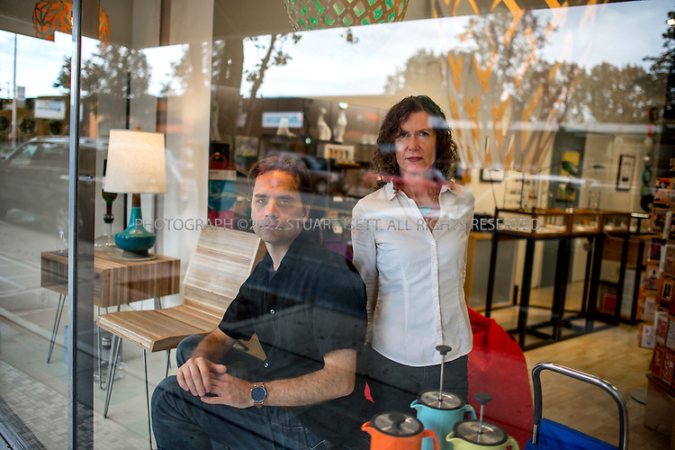 10/20/2014&mdash;Seattle, WA, USA<br /> <br /> John and Frances Smerch, owners of &lsquo;Click! Design That Fits&rsquo; in West Seattle.<br /> <br /> 4540 California Ave SW Seattle WA 98116<br /> http://clickdesignthatfits.com<br /> <br /> Photograph by Stuart Isett<br /> &copy;2014 Stuart Isett. All rights reserved.