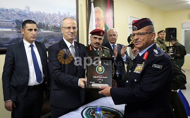 Palestinian Prime Minister Rami Hamdallah attends the graduation ceremony of the first group of Palestinian officers academy students, in the West Bank city of Jericho, on December 19, 2016. Photo by Prime Minister Office