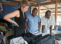 Mary Beth Heffernan, professor of art and art history at Occidental College, works in Monrovia the capital of Liberia, Africa in 2015. Professor Heffernan was there to work on her PPE (personal protective equipment) Portrait Project, which helps health care workers and patients fighting the Ebola virus disease in West Africa.<br />