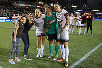 Portland, Oregon - Wednesday September 7, 2016: Portland Thorns FC midfielder Allie Long (10), Portland Thorns FC goalkeeper Michelle Betos (18) and Portland Thorns FC forward Christine Sinclair (12) pose with the Girls, Inc. Girls of the Game after a regular season National Women's Soccer League (NWSL) match at Providence Park.