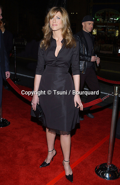 "Jennifer Aniston arriving at the premiere of "" Along Came Polly "" at the Chinese Theatre in Los Angeles. january 12, 2004."