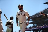 SAN FRANCISCO, CA - JUNE 28:  Brandon Belt #9 of the San Francisco Giants celebrates with teammates Alen Hanson #19 and Brandon Crawford #35 after hitting a home run against the Colorado Rockies during the game at AT&T Park on Thursday, June 28, 2018 in San Francisco, California. (Photo by Brad Mangin)