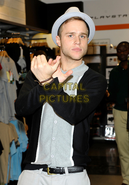 OLLY MURS.X Factor Olly Murs performs a free acoustic show at HMV Chelmsford, meets fans & signs copies of his new single, England..August 30th, 2010.half length grey gray hat black cardigan shirt hands clapping .CAP/CJ.©Chris Joseph/Capital Pictures.