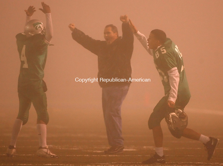 Waterbury, CT-21 November2007-112107MK01 Wilby's #4 Sir Darryll Johnson Head Coach Don Boland celebrate as Wilby's team takes ot the field in vistory admist heavy fog during NVL action against Scared Heart Wednesday night. The Wild Cats defeated the Hearts  33-21  in the last game of the season.  Michael Kabelka / Republican-American  (Wilby's #4 Sir Darryll Johnson Head Coach Don Boland )CQ