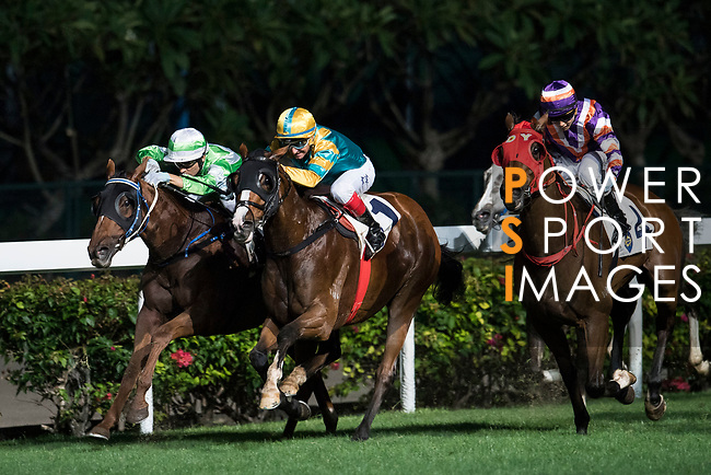 Jockey #4 Matthew Poon Ming-fai riding Crown Avenue (R) during the race 3 of Hong Kong Racing at Happy Valley Race Course on November 29, 2017 in Hong Kong, Hong Kong. Photo by Marcio Rodrigo Machado / Power Sport Images