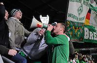 FUSSBALL   1. BUNDESLIGA   SAISON 2011/2012    16. SPIELTAG SV Werder Bremen - VfL Wolfsburg          10.12.2011 Marko Arnautovic (SV Werder Bremen) jubelt nach dem Abpfiff mit einem Megaphon bei den Fans in der Ostkurve