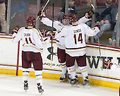 Chris Calnan (BC - 11), Teddy Doherty (BC - 4) and Adam Gilmour (BC - 14) celebrate Doherty's goal which came just 1:22 after Cangelosi's. - The Boston College Eagles defeated the visiting University of New Hampshire Wildcats 6-2 on Friday, December 6, 2013, at Kelley Rink in Conte Forum in Chestnut Hill, Massachusetts.