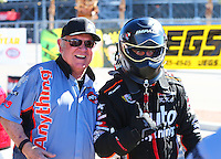 Oct 30, 2015; Las Vegas, NV, USA; NHRA funny car driver Brandon Welch (right) and crew chief / team owner Chuck Beal during qualifying for the Toyota Nationals at The Strip at Las Vegas Motor Speedway. Mandatory Credit: Mark J. Rebilas-USA TODAY Sports