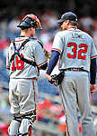 25 September 2010: Atlanta Braves catcher Brian McCann has a chat with Derek Lowe on the mound during action against the Washington Nationals at Nationals Park in Washington, DC. The Braves shut out the Nationals 5-0 to even their 3-game series at one win apiece. The Braves' victory was the 2500th career win for skipper Bobby Cox. Cox will retire at the end of the 2010 season, crowning a 29-year managerial career. Mandatory Credit: Ed Wolfstein Photo