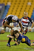 Fritz Lee tries to run through the tackle of Chris Noakes. Air New Zealand Cup rugby game played at Mt Smart Stadium, Auckland, between Counties Manukau Steelers & Otago on Thursday August 21st 2008..Otago won 22 - 8 after leading 12 - 8 at halftime.