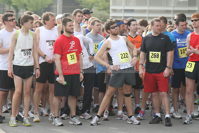 Participants in the Krispy Kreme 5K challenge prepared for the start of the race on Saturday, April 9, 2011 at Commonwealth Stadium. Photo by Brandon Goodwin | Staff