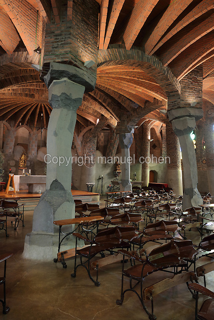 Interior of the Crypta Guell, built 1898-1915, an unfinished church by Catalan Modernist architect Antoni Gaudi, 1852-1926, in the Colonia Guell, a workers' colony set up by Eusebi Guell in Santa Coloma de Cervello, Barcelona, Catalonia, Spain. The church is an organic hyperbolic paraboloid shape, with leaning pillars of basalt and brick and catenary arches supporting the structure and brick ribs vaults supporting the ceiling. The colony was begun in 1890 on Guell's estate Can Soler de la Torre, with a hospital, boardinghouse, schools, shops, theatres, chapel, factories and workers' housing. Gaudi was in charge of the project, collaborating with Francesc Berenguer, Joan Rubio and Josep Canaleta. Gaudi's crypt is listed as a UNESCO World Heritage Site. Picture by Manuel Cohen