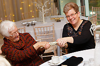 Pictured: Guests have fun during the party. Wednesday 28 November 2018<br /> Re: National Lottery millionaires from south Wales and the south west of England have hosted a glitzy Rat Pack-inspired Christmas party for an older people's music group at The Bear Hotel in Cowbridge, Wales, UK.