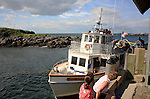 The Elizabeth Ann tying to a dock,  Monhegan Island, Monhegan Plantation, Lincoln County, Maine, USA