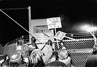 Undated file photo File photo. <br /> <br /> United Aircraft employees on strike throw  sign above the plant's fence into a fire.<br /> <br /> The strike which turn out to be very violent lasted from January 9,1974 to May 20, 1975.<br /> <br /> <br /> <br /> Photo : AQP - Alain Renaud