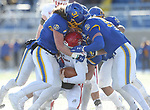 BROOKINGS, SD - NOVEMBER 17: Eric Kleinschmit #31 and Ryan Earith #90 from South Dakota State University bring down Austin Simmons #3 from the University of South Dakota during their game Saturday afternoon at Dana J. Dykhouse Stadium in Brookings, SD. (Photo by Dave Eggen/Inertia)