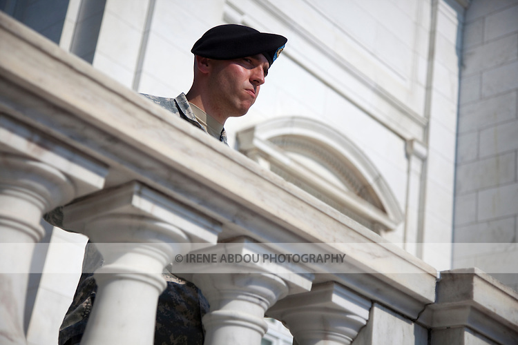 A soldier watches the changing of the guard at the Tomb of the Unknown Soldier at Arlington National Cemetery in Virginia.