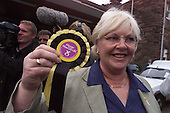 SNP candidate, and former MP, Margo MacDonald with a rosette - black, yellow and purple colours of the day for SNP - that she has kept since her Hamilton victory .... Pic Donald MacLeod