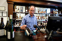 Co-owner David Lillie scans bottles at Chambers Street Wines in New York, NY, USA, 22 May 2009. The store specializes in naturally made wines from artisanal small producers and has received a Slow Food NYC Snail of Approval.
