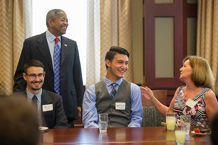 President McDavis converses with the Templeton Scholars at his final reception for them on Sept. 7, 2016.