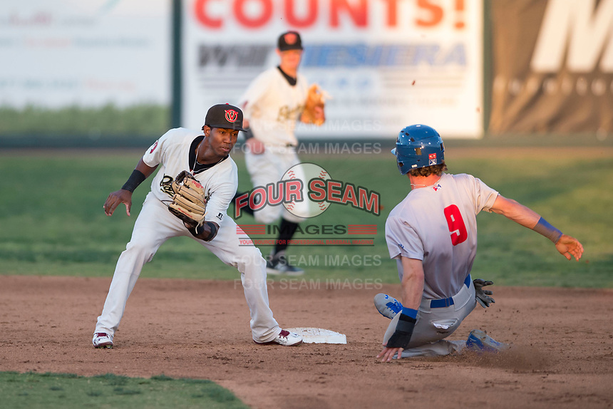 Visalia Rawhide second baseman Raymel Flores (1) prepares to apply the tag to Skye Bolt (9) on a stolen base attempt during a California League game against the Stockton Ports at Visalia Recreation Ballpark on May 8, 2018 in Visalia, California. Stockton defeated Visalia 6-2. (Zachary Lucy/Four Seam Images)