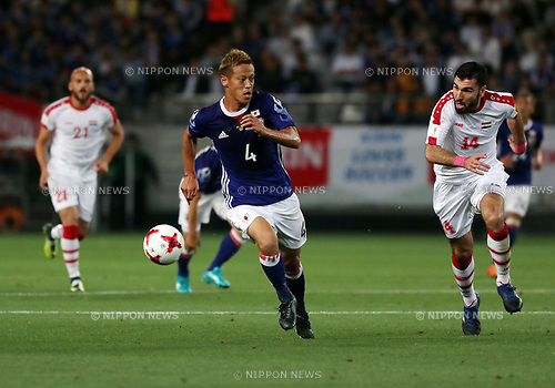 June 7, 2017, Tokyo, Japan - Japan's Keisuke Honda chases the ball with Syrian player during a friendly match between Japan and Syria Kirin Challenge Cup in Tokyo on Wednesday, June 7, 2017. Japan and Syria drew the game 1-1.  (Photo by Yoshio Tsunoda/AFLO) LwX -ytd-
