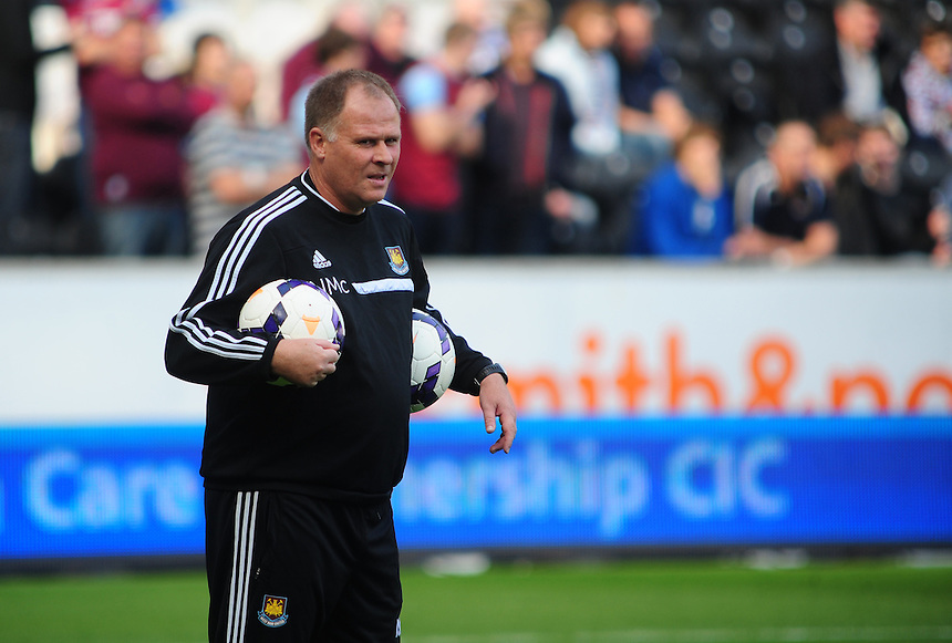 West Ham United's assistant manager Neil McDonald during the pre-match warm-up <br /> <br /> Photo by Chris Vaughan/CameraSport<br /> <br /> Football - Barclays Premiership - Hull City v West Ham United - Saturday 28th September 2013 - Kingston Communications Stadium - Hull<br /> <br /> &copy; CameraSport - 43 Linden Ave. Countesthorpe. Leicester. England. LE8 5PG - Tel: +44 (0) 116 277 4147 - admin@camerasport.com - www.camerasport.com