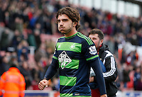 Swansea City's Alberto Paloschi celebrates at the final whistle during the Barclays Premier League match between Stoke City and Swansea City played at Britannia Stadium, Stoke on April 2nd 2016