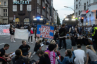 GERMANY, Hamburg, protest rally on Reeperbahn in St. Pauli against G-20 summit in july 2017, sitting protester in front of police water cannon / DEUTSCHLAND, Hamburg, St. Pauli, Protest Demo auf der Reeperbahn gegen G20 Gipfel in Hamburg, Sitzblockade vor Wasserwerfern an der Polizeistation Davidwache