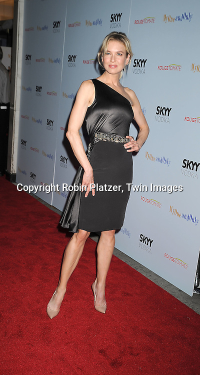 actress Renee Zellweger in Caroline Herrera gray dress