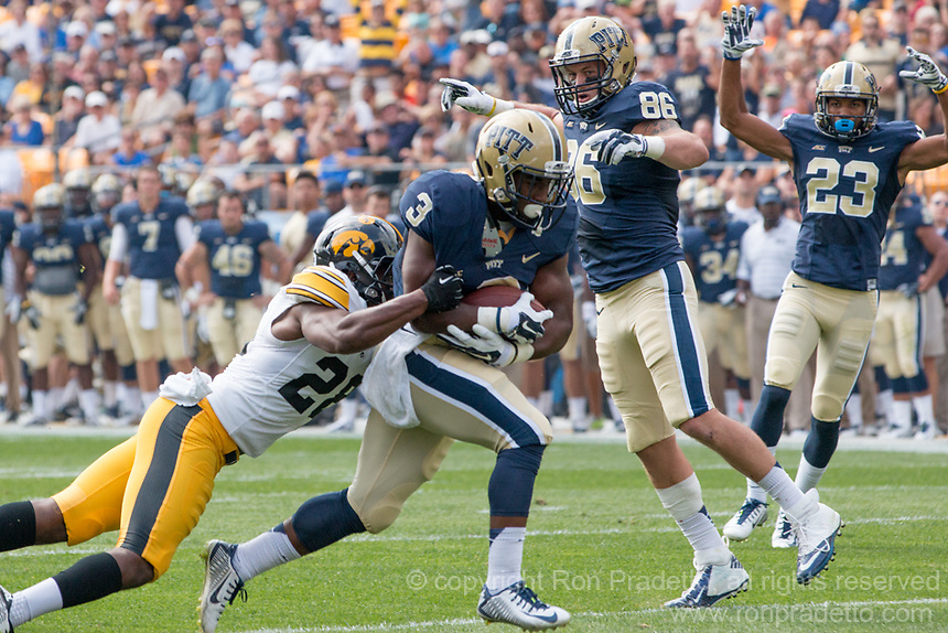 Pitt running back Chris James (3) scores on a14-yard touchdown run. Iowa Hawkeyes defeated the Pitt Panthers 24-20 at Heinz Field, Pittsburgh Pennsylvania on September 20, 2014.