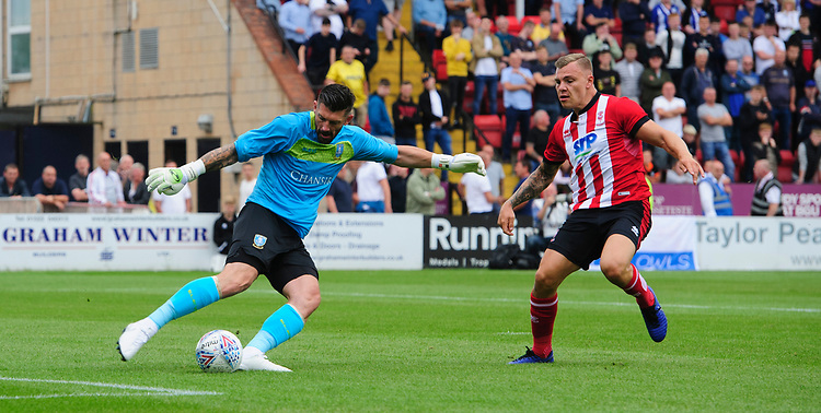 Sheffield Wednesday's Kieren Westwood under pressure from Lincoln City's Harry Anderson<br /> <br /> Photographer Chris Vaughan/CameraSport<br /> <br /> Football Pre-Season Friendly - Lincoln City v Sheffield Wednesday - Saturday July 13th 2019 - Sincil Bank - Lincoln<br /> <br /> World Copyright © 2019 CameraSport. All rights reserved. 43 Linden Ave. Countesthorpe. Leicester. England. LE8 5PG - Tel: +44 (0) 116 277 4147 - admin@camerasport.com - www.camerasport.com