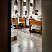Priests pray wearing special vestments in the chapel at the headquarters of the Legionaries of Christ in Rome. The Legion of Christ is a conservative Roman Catholic congregation whose members take vows of chastity, obedience and poverty. The members here pray for three everyday.