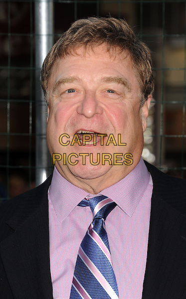 "John Goodman.""Trouble With The Curve"" Los Angeles Premiere held at the Regency Village Theatre, Westwood, California, USA..September 19th, 2012.headshot portrait suit black blue tie pink shirt  mouth open.CAP/ROT/TM.©Tony Michaels/Roth Stock/Capital Pictures"
