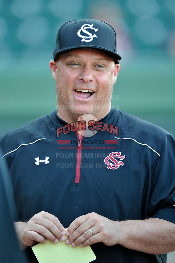 Head coach Chad Holbrook (2) of the South Carolina Gamecocks laughs during the pregame conference with the umpires before a game against the USC Upstate Spartans on Tuesday, March 15, 2016, at Fluor Field at the West End in Greenville, South Carolina. (Tom Priddy/Four Seam Images)