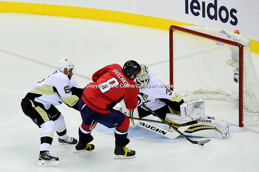 Thursday, April 28, 2016: Washington Capitals left wing Alex Ovechkin (8) takes a shot against Pittsburgh Penguins goalie Matt Murray (30) during game 1 of round 2 of the NHL Eastern Conference playoffs between the Pittsburgh Penguins and the Washington Capitals held at the Verizon Center in Washington DC. The Capitals defeat the Penguins 4-3 in overtime. Eric Canha/CSM