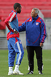 19 November 2010: Schellas Hyndman, Head Coach of the FC Dallas (right) has a word with Atiba Harris.  FC Dallas held a practice at Toronto, Ontario, Canada as part of their preparations for MLS Cup 2010, Major League Soccer's championship game.