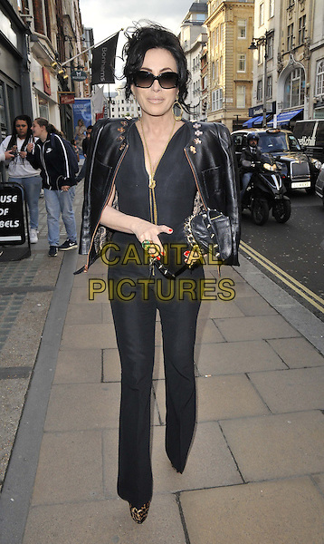 LONDON, ENGLAND - MAY 22: Nancy Dell'Olio attends the Contini Art UK new gallery launch &amp; private view, Contini Art UK gallery, New Bond St., on Thursday May 22, 2014 in London, England, UK.<br /> CAP/CAN<br /> &copy;Can Nguyen/Capital Pictures