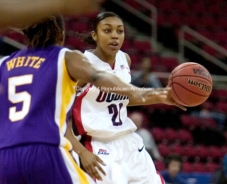 FRESNO, CA. 26 March 2007-032607SV06--#20 Renee Montogomery of UConn looks to pass inside as #5 Erica White of LSU defends during the elite eight round of the NCAA tournament at the Save Mart Center in Fresno, CA. Monday.<br /> Steven Valenti Republican-American