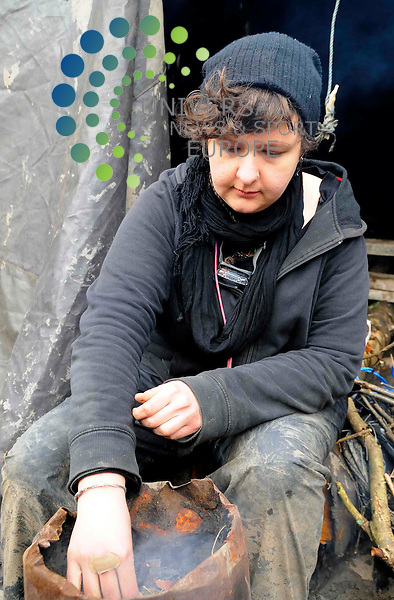 Rosa (25), keep the camp fire burning at the tree felling protest site in Oakley, Fife today. Fresh supplies of wire, rope, food have helped to grow the sites strength as well as keep moral good within the camp of 20 who have occupied the site to stop tree felling by UK Coal who plan to develop a new open cast coal mine. Today/Universal News and Sport (Scotland)/Derek Fett/23rd March10 ..
