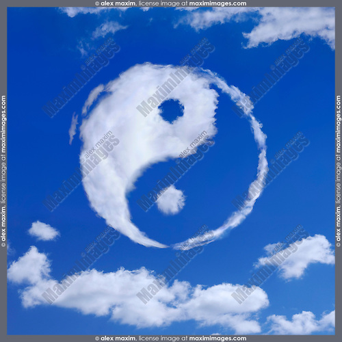 Yin-Yang spiritual symbol made from white clouds in blue sky. Meditation, spirituality concept.