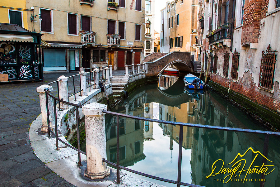 Canal reflections, morning in Venice Italy before everyone awakes.