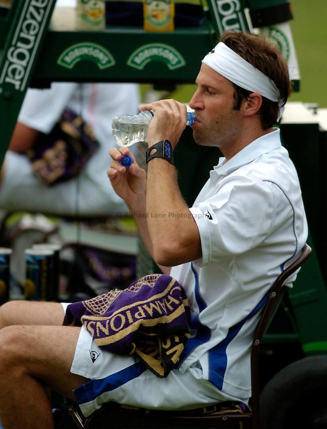 Photo: Richard Lane..Wimbledon Championships. 27/06/2006. .Great Britain's Greg Rusedski takes a drink.