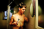 New York City, 2011. Ben having a shower in his flat and shaving his chest before dressing up as Honey LA Bronx, Drag Queen and political activist. Honey was arrested at the beginning of march for stopping the traffic in Manhattan with a huge banner for gay rights.