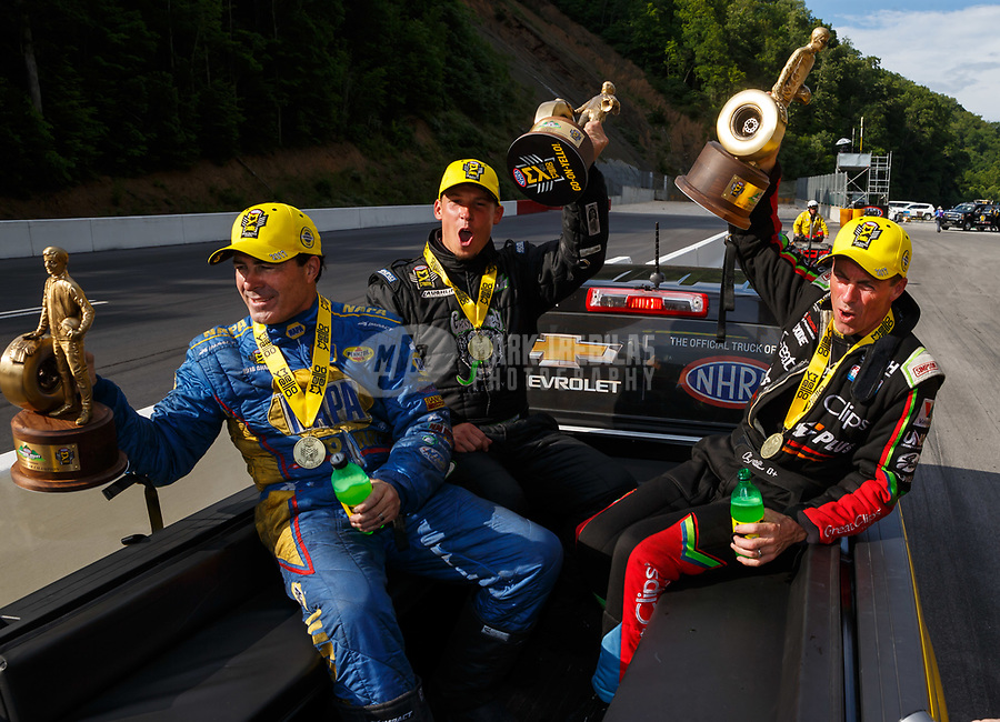 Jun 18, 2017; Bristol, TN, USA; NHRA funny car driver Ron Capps (left), pro stock driver Alex Laughlin (center) and top fuel driver Clay Millican celebrate after winning the Thunder Valley Nationals at Bristol Dragway. Mandatory Credit: Mark J. Rebilas-USA TODAY Sports