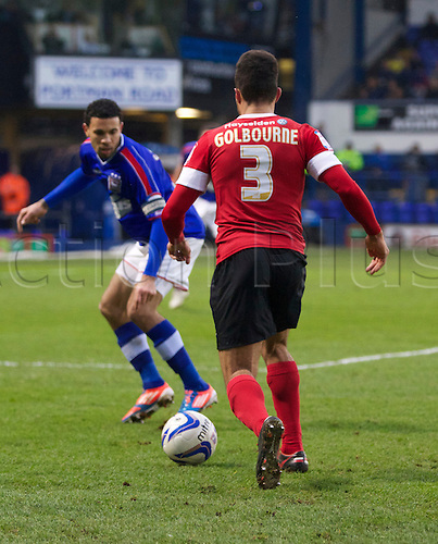 19.01.2013 Ipswich, England.  Scott Golbourne takes on Carlos Edwards during the Championship game between Ipswich Town and Barnsley at Portman Road.