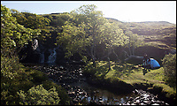 BNPS.co.uk (01202 558833)<br /> Pic: WildGuideScotland/BNPS<br /> <br /> Camping in Eas Fors, Ballygown, on the Isle of Mull.<br /> <br /> Scotland's stunning unspoiled scenery is being shown in a whole new light in a book that reveals the hidden gems off the beaten track north of the border.<br /> <br /> Three young photographers travelled the width and breadth of Scotland and snapped 750 picturesque places which include shimmering lochs, ancient forests, lost ruins, hidden beaches, secret islands, dramatic cliffs, tiny glens and mysterious grottoes. <br /> <br /> Friends Kimberley Grant, David Cooper and Richard Gaston, all in their late 20s, have spent the past two years exploring lesser known idyllic spots which they are keen to bring to a wider audience.